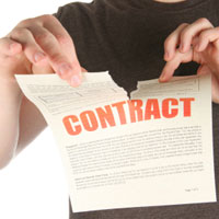 Image of man tearing contract in half.